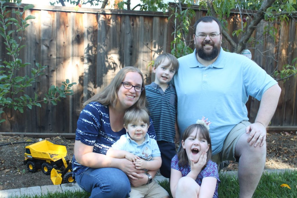 Family of five: woman, man, young girl, and two young boys.