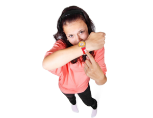 Woman holding up watch and pointing to it